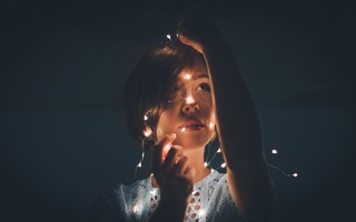 girl wrapped in fairy lights